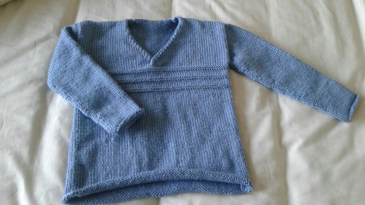 The Sixteenth Little Sublime Hand Knit Book.  Rollo in double knit.  Lovely pattern to knit up and could easily be for a girl or boy.  Like the neck closing, but there's not much stretch to get little heads through