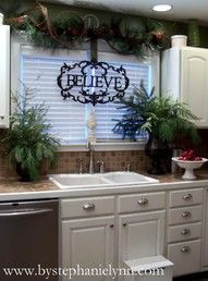 Use a tension rod between cabinets above sink. Plus this site has a million beautiful Christmas decorations.