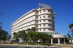 """Streamline moderne: """"Normandie Hotel, in San Juan, Puerto Rico, was inspired by SS Normandie, the ship, and includes the ship's original sign."""""""
