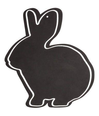 En griffeltavla i form av en kanin. Hål för upphängning upptill. Skruv medföljer ej. Storlek ca 29x32 cm.