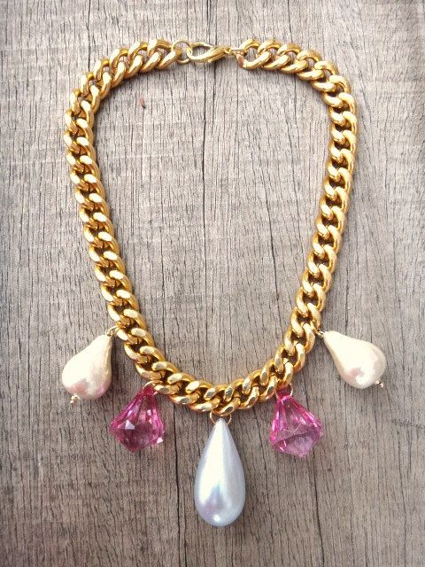 Handmade necklace with gold-plated aluminum chain and ivory paper mache tear drop shaped beads, pink diamond shaped acrylic beads and light blue tear drop shaped beads. Gold plated brass closure.  This design it will go with everything from party dresses to sweatshirts.  The adjustable clasp