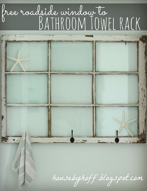 An old window gets turned into a bathroom towel rack!