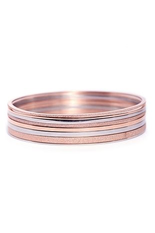 EDBLAD Segments Bangle Rose Gold. Sparkle and shine, this rose gold and stainless steel bangle is sure to turn heads. $159.95