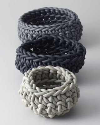 These hand knit neoprene baskets have an industrial look and add flexible