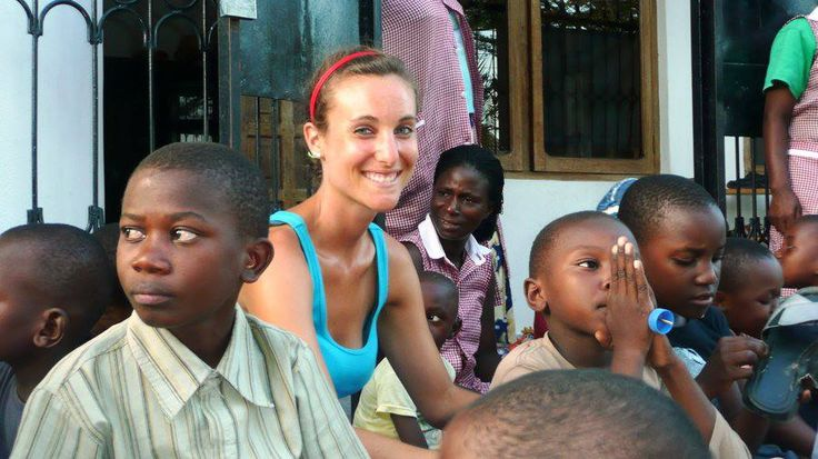 Volunteer Jenna sits with the kids at the help2kids Children's Home