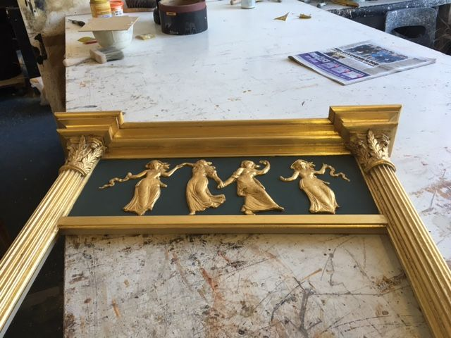 Bespoke finish - dark bottle green (RAL 6009) with Dutch Gold Leaf frame and nymph moulding.  No28 Frame style.  http://www.overmantels.co.uk/list/pier-glasses-triptychs