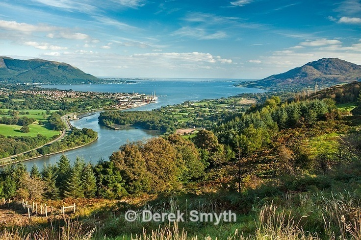The classic view of Carlingford Lough as taken from the Flagstaff view point. Narrow Water Castle can be seen on the left bank of the river and in the distance is the town of Warrenpoint.