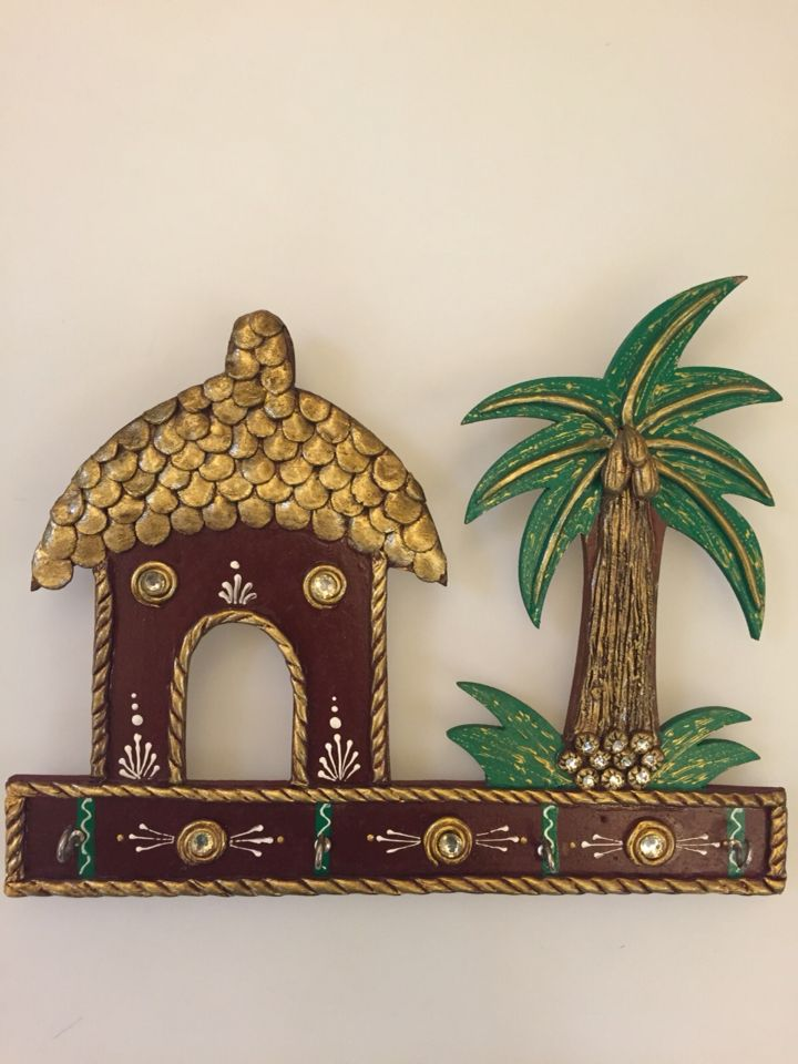 Hand crafted key holders. Material used wood Hut and a palm tree