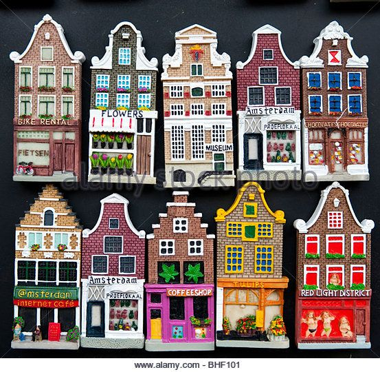 Many fridge magnets in shape of traditional dutch houses in Amsterdam Netherlands - Stock Image