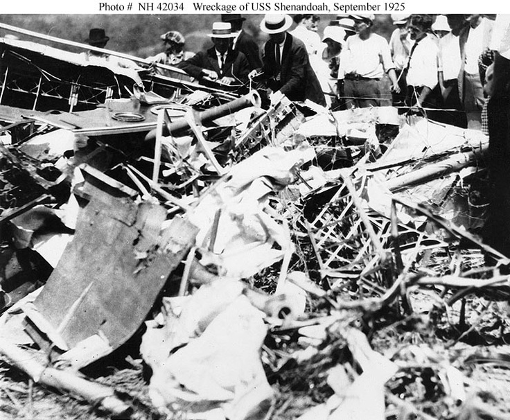 Crash of USS Shenandoah (ZR-1), 3 September 1925    Local residents examining some of the airship's wreckage, soon after she crashed in southeastern Ohio.  Photograph was received from the Office of Naval Intelligence, 7 November 1940.    U.S. Naval Historical Center Photograph.