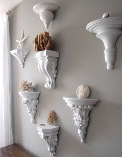 I like the mismatched sconces all painted the same to display any kind of collection.