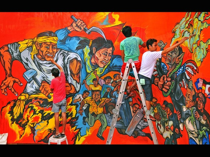Preparing for May Day rally. Beautiful and fiery murals are always a part of protest rallies in the Philippines.