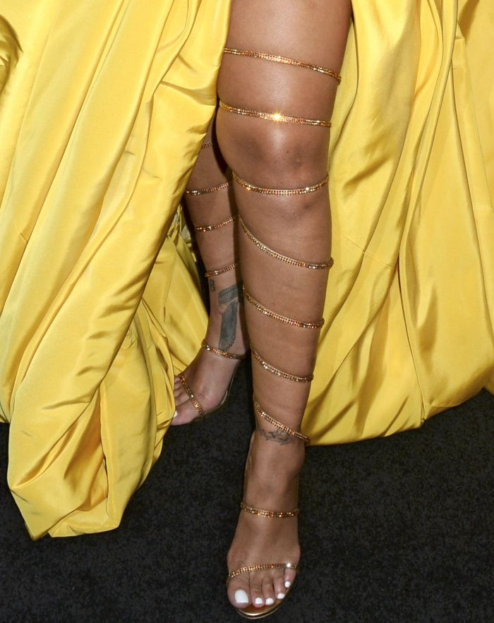 a26e5c3a3d ... wearing custom gold Rene Caovilla over-the-knee gladiator sandals at  the Fenty Beauty by Rihanna lunch | Rene Caovilla in 2019 | Shoes, Open toe  sandal…