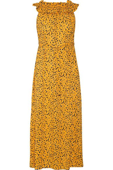 Breezy silhouettes and vibrant florals are the defining details in MICHAEL Michael Kors' Pre-Fall '17 collection. Cut from lightweight stretch-crepe, this marigold and navy midi dress has a ruffled, smocked neckline and self-tie belt that tempers the slightly loose fit. Style yours with chunky platform sandals.