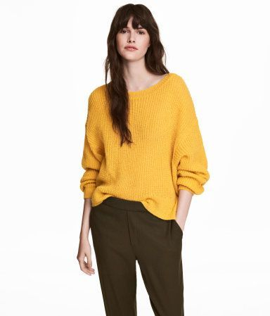 Yellow. Soft, loose-knit sweater with low, dropped shoulders and ribbing at cuffs and hem. Longer at back.