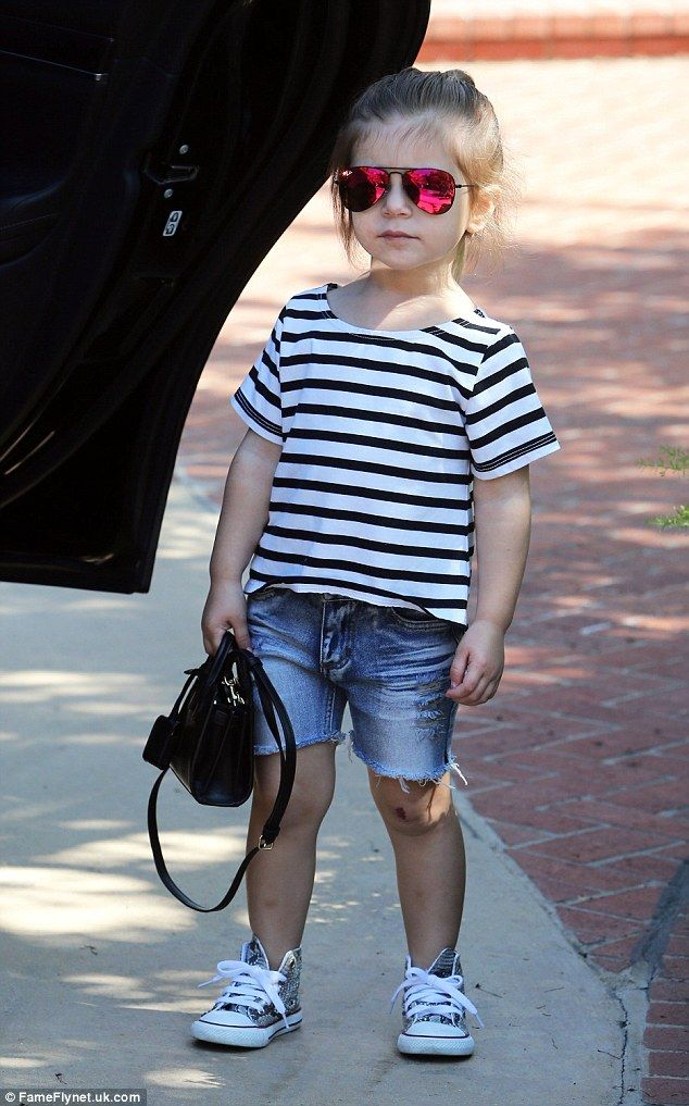 Too cool for school: Penelope stole the show in her cute outfit that looked handpicked by mom. The tot had on a striped sailor shirt in black and white with a pair of cut-off ripped denim shorts