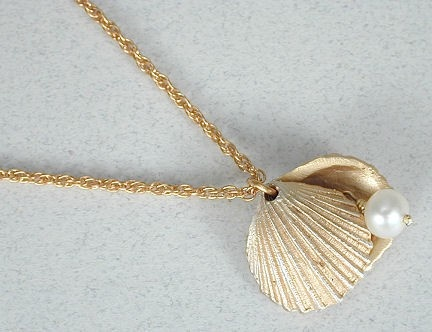seashell locket (two parts swing aside to reveal photo, etc.)