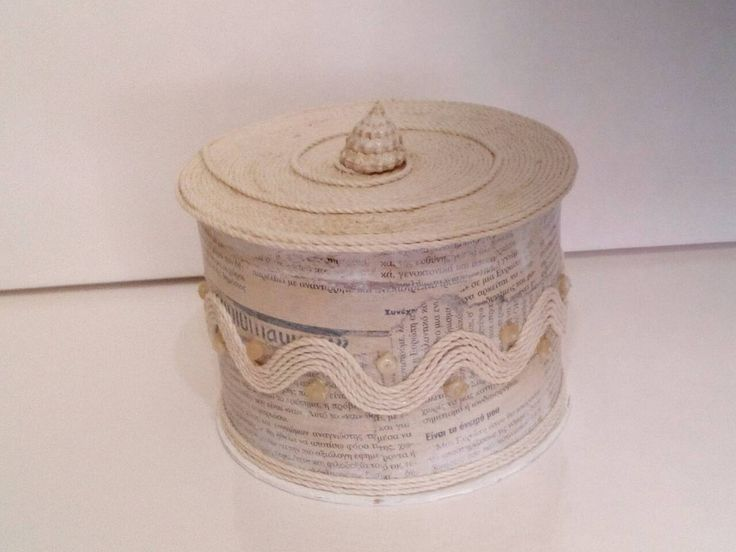 storage box made out of Cable reel, οld newspaper, some cord, sea stones and shell for the lid