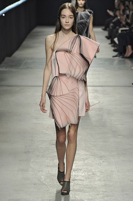 Fashion designer Christopher Kane's Autumn Winter 2014 collection shown at London Fashion Week features outlined layers of fabric that overlap like fluttering sheets of paper
