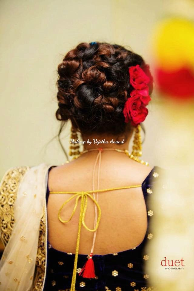 Gorgeous bridal updo by Vejetha for Swank. Bridal hairstyle. Bridal hair updo. South Indian bride. Bridal lehenga. Hair accessory.