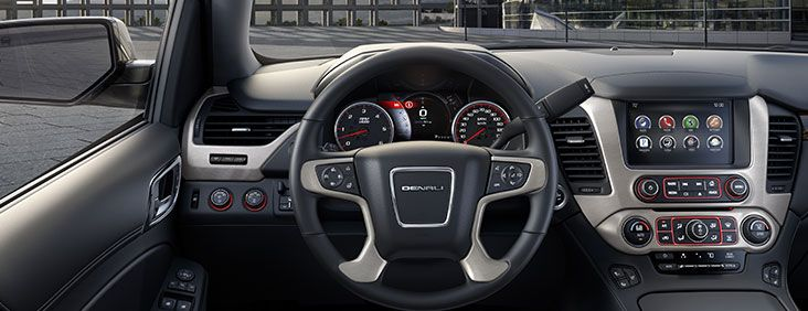 Driver's dash and the center console of the 2015 Yukon Denali full size luxury SUV.
