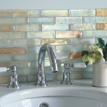 #bldgproductoftheday handmade iridescent glass mosaic tile! I haven't seen anything quite like it; it has an amazing seashell effect and reflects light in such a nice way. Would be great if you want to give your bathroom a luxury spa feel.
