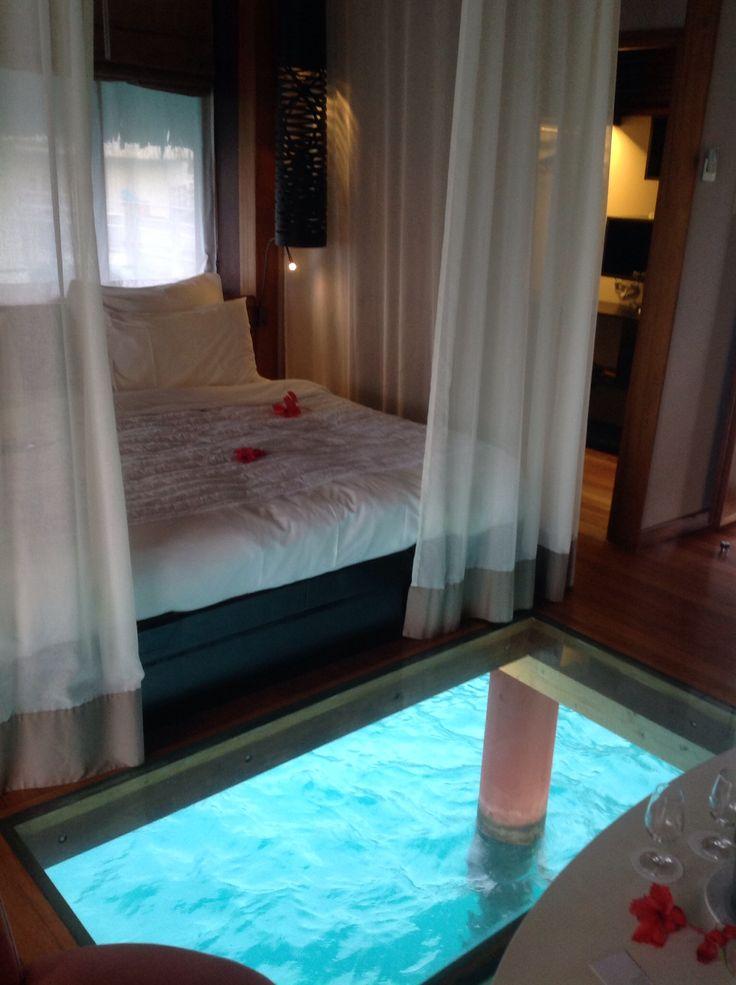Bora Bora Bedroom, love how you can see the sea through the floor!♥