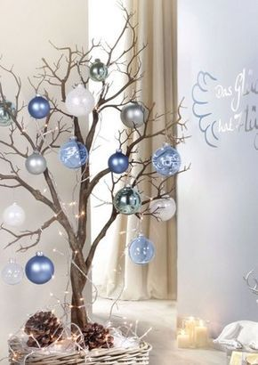 Winter tree in blues and whites with holiday balls