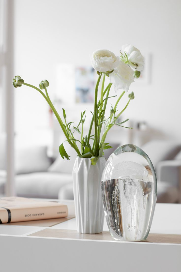 Flowers, vase and sculpture