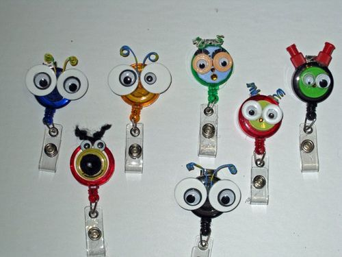 "My newest ""flip top"" craft. I used the throw-away tops to the medication vials at work as the inspiration for these cute little ""Bugs"" on ID badge reels. I just LOVE them and I know there is more to come! by luvmibug, via Flickr"