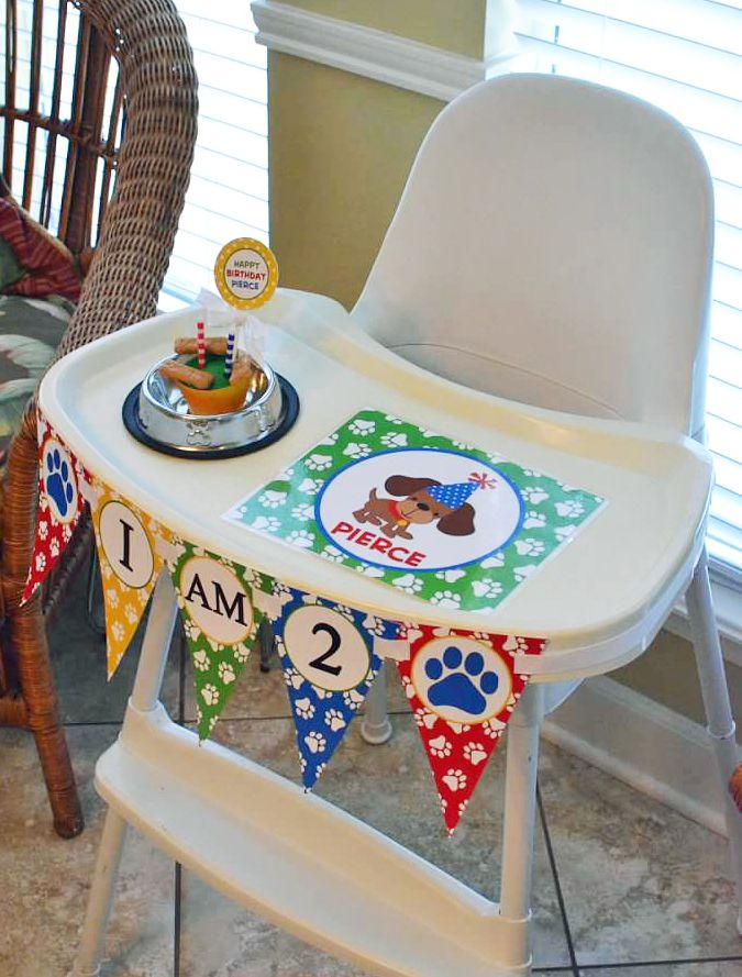 """Puppy Dog Birthday Party highchair decorations for the birthday boy by That Party Chick!  """"I am 2"""" banner, placemat and cupcake topper!  For details on this cute party and party printables visit www.thatpartychick.net!"""