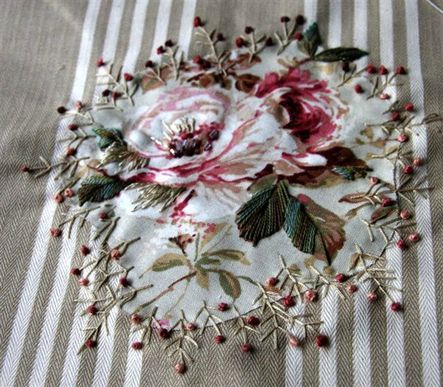 Place floral fabric on stripe, stitch edges, follow and enhance pattern
