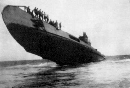 Grounded Dutch submarine O-19 in South China Sea, 8 July 1945. The crew is rescued by sub USS Cod, the only international sub-to-sub rescue in history. (US Navy photo)
