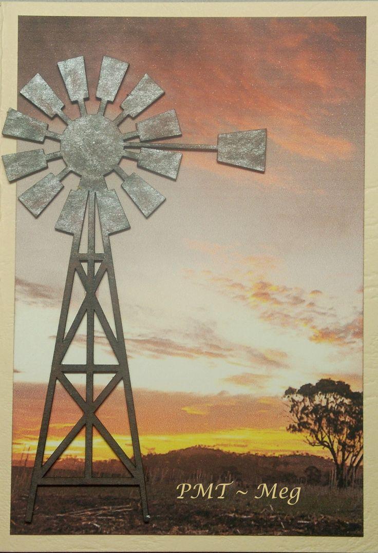 An iconic Australian scene: a windmill at sunset.