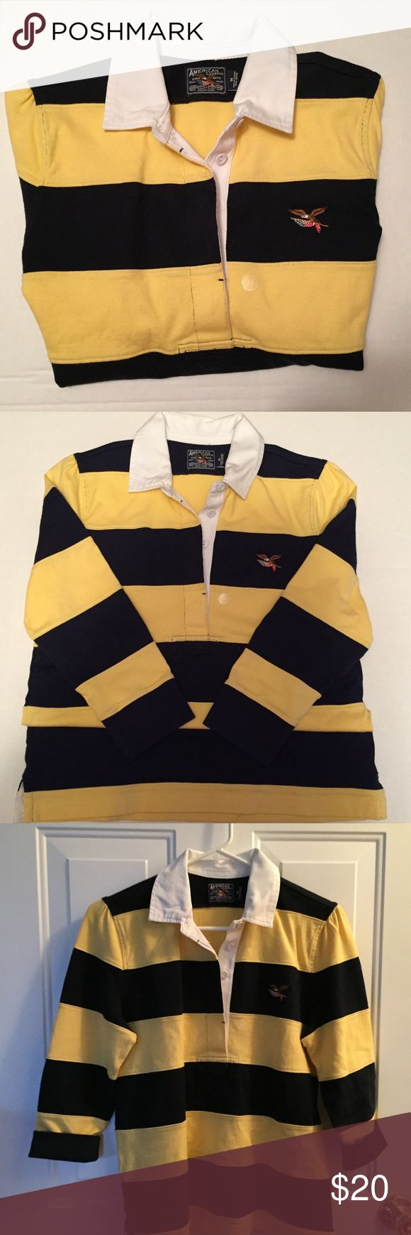 """Polo Shirt by American Living Sz M Juniors American Living Polo with Small American Flag and Eagle on Chest.Hidden Button Placket 3/4 Sleeves. The Cuffs can be Turned up. Deep Navy and Yellow. Size M Runs Small. 23"""" Long From Shoulder to End of Hem.18"""" Armpit to Armpit. Sleeves 18.5"""" From Shoulder to End of Cuff. Never Worn. 100% Cotton Tops"""