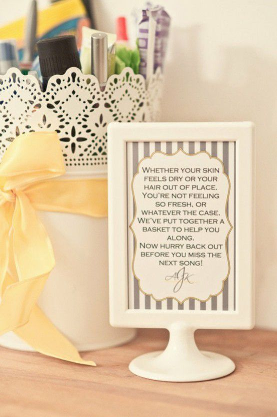A bathroom emergency kit for your wedding guests including aspirin, Band-Aids, bobby pins, mints and more!   Photo: Drew and Megan Photography