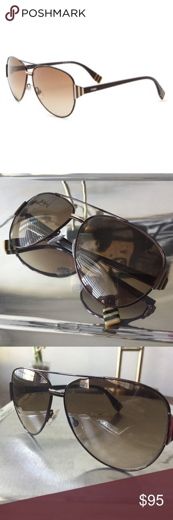 Fendi // 0018 Women's Aviator Sunglasses The Fendi 0018 sunglasses are sleek oversized metal aviators featuring the Fendi logo on the temples. High quality gradient lenses provide 100% UV protection. Color is brown. No scratches in perfect condition do not have sunglasses case. Fendi Accessories Sunglasses