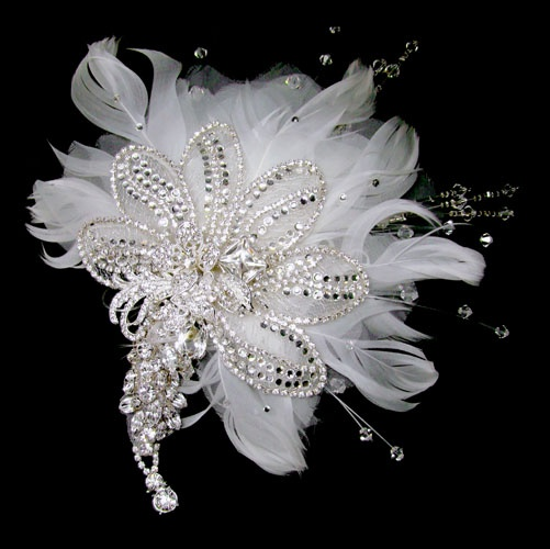 Dramatic feather and swarovski feature headpiece