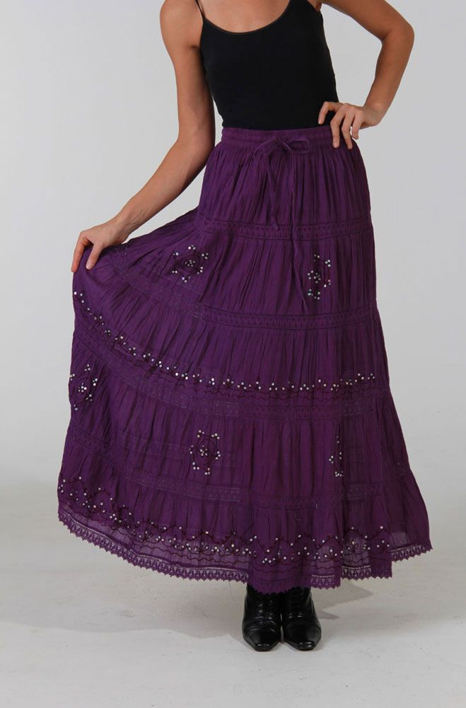 "Purple color tiered skirt  in cotton has hand sewn silver color sequines with dyed to match lace trim in between the tiers.  This is one of the most feminin skirts with elastic waist and draw string.Great with our western shawls or western T-shirts.  The length measures about 36"".  100% cotton.  Hand wash or machine wash cold.  One size will fit up to size 18"