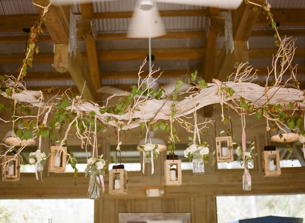 String up a large driftwood branch, and decorate! love the greens, and I would do flowers instead of the hanging frames but it's cute