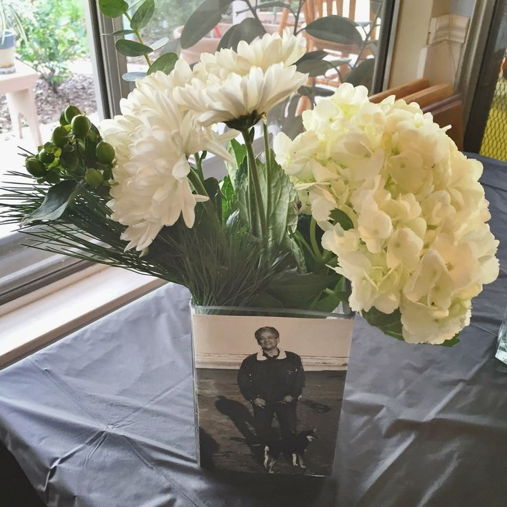 Photo floral arrangement centerpiece from dad 39 s milestone for Decoration 70th birthday