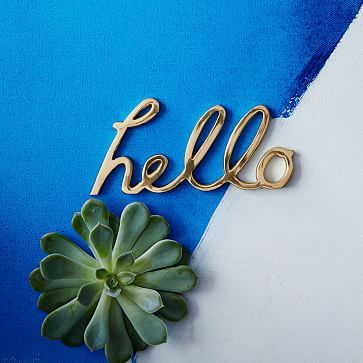 It's only the size of a Hershey bar, or an iPhone 6, but I love that it's in brass. Nice script, too. Hello Word Object #westelm