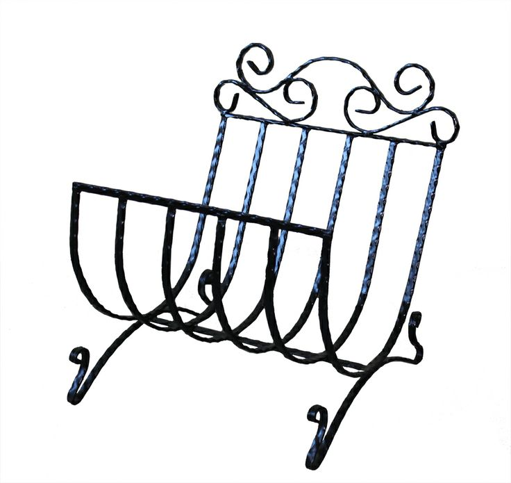 Your cozy fireplace would look great with some wrought iron items like this elegant wood basket.