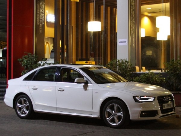 The new Audi A4, Audi's best selling sedan, offers a number of advantages over its predecessor in terms of features, performance, technology and surprisingly even price. The base model, 1.8 TFSI, priced at Rs.27.33 lakhs (ex showroom Maharashtra), is a good Rs.60,000 to Rs.70,000 cheaper than the outgoing model which considering present hike in Euro is rather strange.