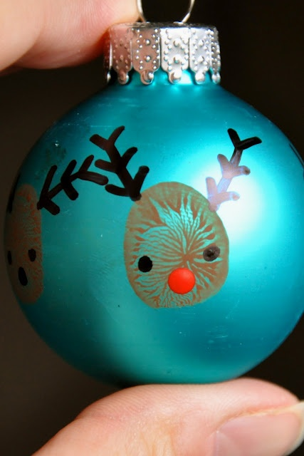 "kids' thumbprint reindeer ornaments. this makes me want to do a ""baby's first christmas"" ornament with a hand print."