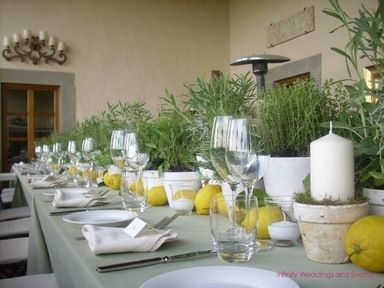 using herbs and lemons for centerpieces, along with whitewash clay pots for candles.  Ben could start growing herbs now!