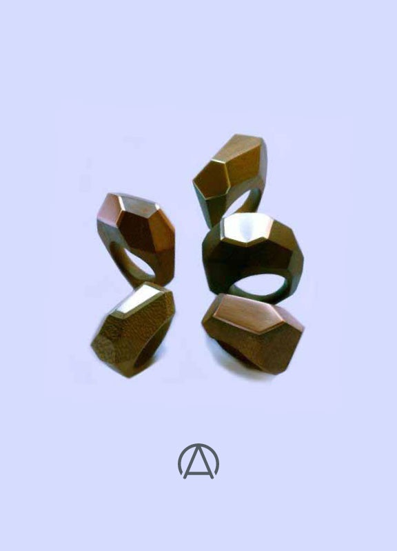 Gorgeous faceted rings made from wood and various metals by Dor Available soon from www.africandy.com