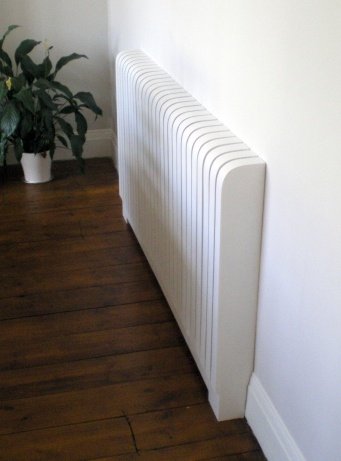 Modern designer radiator cover painted white.