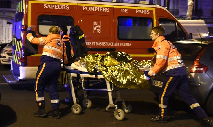 President says France will defend itself after at least 128 people killed in series of gun and bomb attacks across Paris