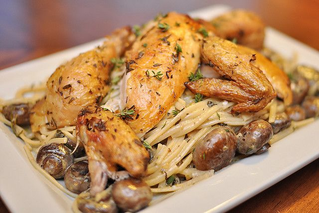Let's stuff a chicken! Rub down your bird with lots of herbs, then grab your favorite fruits or vegetables and get stuffing. Lemon, garlic, apples or onions, it doesn't matter. Just throw that clucker in the oven and start roasting. You can even roast more than one at a time!